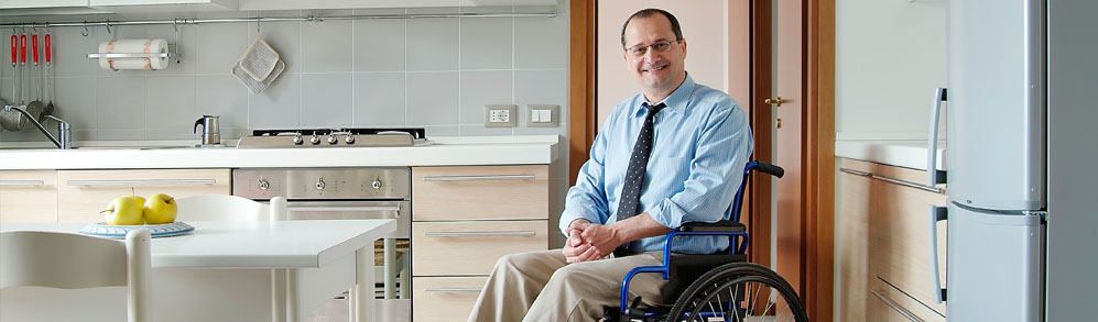 Man in a wheel chair in a kitchen with good accessibility