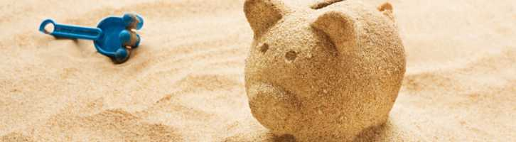 Piggy bank made of sand to represent the money aspects of vacation rental management