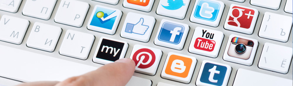 Social media icons on a keyboard to show social media can attract more visitors to your website.